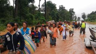 Villagers rescued from flooding after dam collapses. 24 July 2018