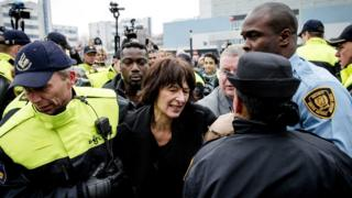 Florence Hartmann is detained by Dutch police and UN security personnel in The Hague. 24 March 2016