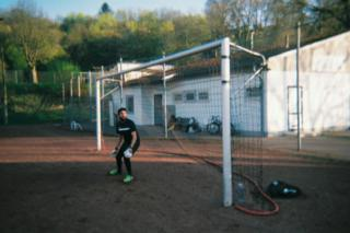football A goalkeeper stands in a goal