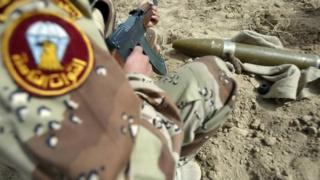 An Iraqi army soldier inspects a Katyusha rocket (21 March 2008)