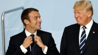 US President Donald Trump (R) and French President Emmanuel Macron talk at the G20 summit in Hamburg on 7 July