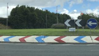 Roundabout with red, white and blue paint daubed on it in Limavady