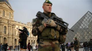 A soldier guarding The Louvre in Paris