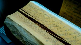 Log with prisoner's message scrawled on it