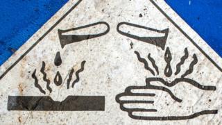Corrosive substance warning sign