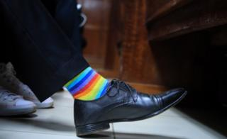 A Kenyan LGBT activist wears rainbow socks as he and his friends wait for a court ruling on an anti-homosexual law at a court in Nairobi, Kenya, 22 February 2019