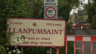 Sign for Llanpumsaint