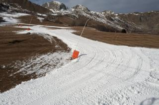 A new track is being shovelled together with snow generated by snow cannons