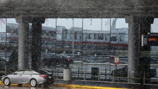 Snow falls outside Chicago's O'Hare airport, the nation's fourth busiest airport