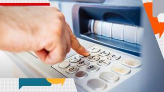 Cash machine in use.