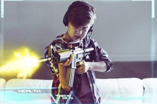 Boy fires fun in computer game