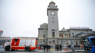 Fire engine and emergency workers outside