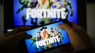 A man playing Fortnite on a smartphone