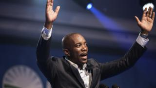 Mmusi Maimane, the newly elected leader of South Africa's main opposition Democratic Alliance (DA) party, gestures as he gives his maiden speech following his election in Port Elizabeth, South Africa, on May 10, 2015