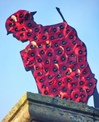Poppies on a soldier shaped sculpture