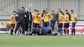 The scene following the footballer's injury during the Slough Basingstoke match in Arbour Park.