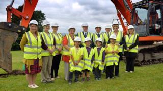 Pupils from Trimsaran School with contractors Dawnus Construction