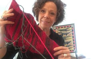 Sue Montgomery holds up her knitting