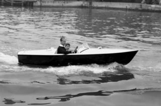 Prince Charles with his father the Duke of Edinburgh in a motor boat