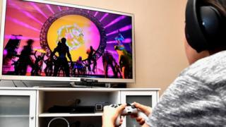 Person watching concert in Fortnite