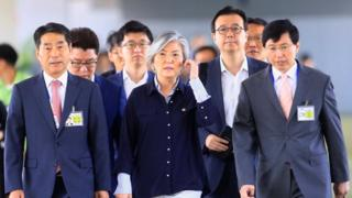 South Korean Foreign Minister Kang Kyung-wha is escorted by South Korean officials upon arrival at the international airport in Pasay city