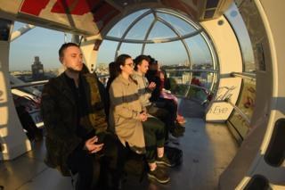 Londoners on the London Eye during the solstice sunrise