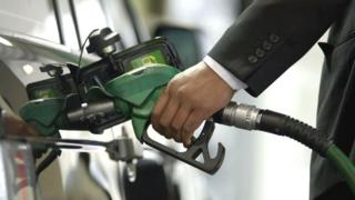 environment A man filling his car with petrol