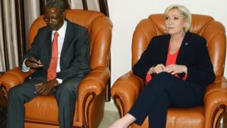 French far-right Front National (FN) party candidate for the presidential election Marine Le Pen (R) sits next to Chadian president cabinet director Mahamat Hissein