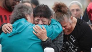 Mourners are comforted during a memorial service for the 26 people killed at the First Baptist Church of Sutherland Springs, Texas (10 November 2017)