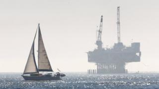 An oil rig is seen off the Pacific Ocean coastline after the Trump administration announced plans to dramatically expand offshore drilling, at Seal Beach, California, USA, 4 January 2018
