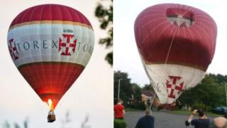 The hot air balloon coming down to land
