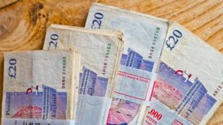 Four bundles of £20 notes