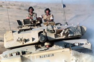 Prince of Wales (left) riding in a Challenger tank of the Royal Scots Dragoon Guards (7th Armoured Brigade) with Brigadier Patrick Cordingley