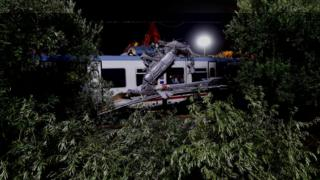 Trees frame the site where two passenger trains collided