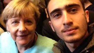 Anas Modamani with Angela Merkel