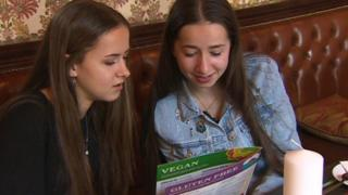 Cerys and Cadi Davage holding a menu
