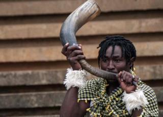 A supporter blows in a horn during the 2019 Africa Cup of Nations qualifier match between Kenya and Ghana, at the Kasarani Stadium in Nairobi, on September 8, 2018.