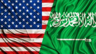 Флаги США и Саудовской Аравии