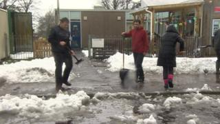 Parents helped to clear snow to allow Creigiau primary school, near Cardiff, to reopen on Monday
