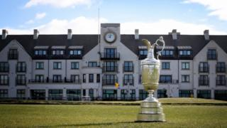 The Claret Jug on the 18th hole in front of Carnoustie Golf Club