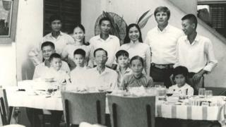 Dick Swanson and Germaine with her family in Saigon