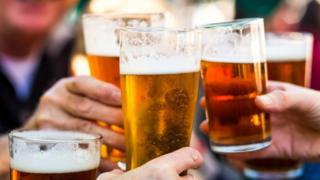 People drinking pints of beer