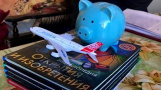 Encyclopaedias and a piggy bank were among the items an 8-year-old boy set off with to travel the world