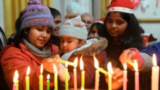 in_pictures Christian devotees light candles on Christmas Day at St.Paul Church in Amritsar