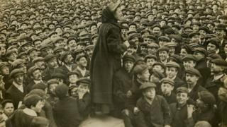 Katherine Douglas Smith speaking to a crowd of men (taken between 1906-1914)