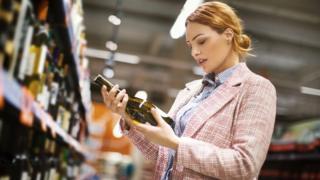 Woman choosing wine