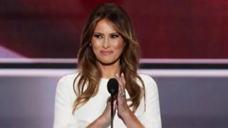 The advert shows Melania Trump in front of a microphone in a pale dress, like the one she wore to the Republican National Convention in 2016