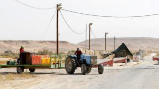 Thai farm workers drive along the Israeli-Jordanian border on October 23, 2018