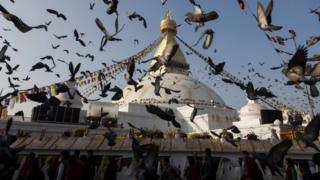 Pigeons flying in front of Boudhanath Stupa during the opening ceremony of the stupa in Kathmandu (22 November 2016)