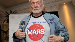 Buzz Aldrin shows off his t-shirt highlighting his campaign for human exploration of Mars